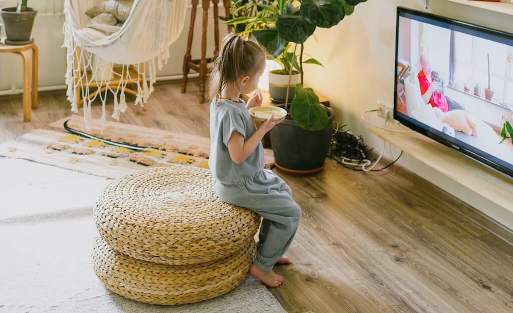 child eating in front of the tv