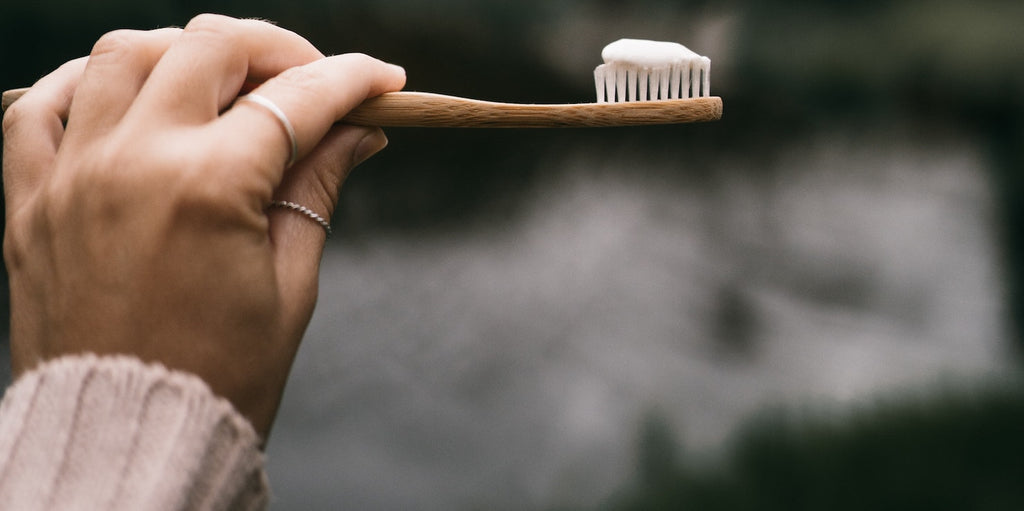 woman holding tooth brush with tooth paste