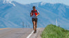Ultra Runner Michael McKnight crests hill with Bear River mountain range in background