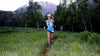 Trail runner running across field at Squaw Peak - Susie Kramer