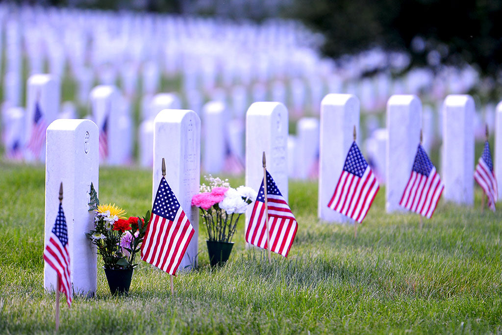 Line of headstones with flags on them at Arlington National Cemetery
