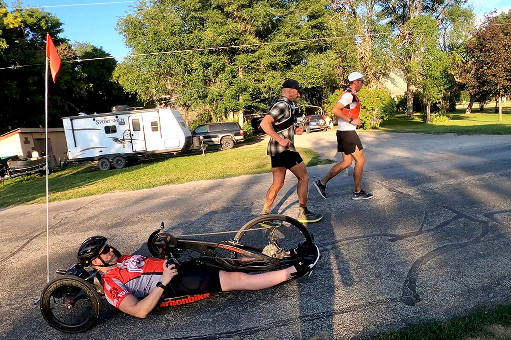 Paraplegic Austin Patten hand cycling with ultra runners Ben Light and Mike Mcknight through Hyrum, Utah.