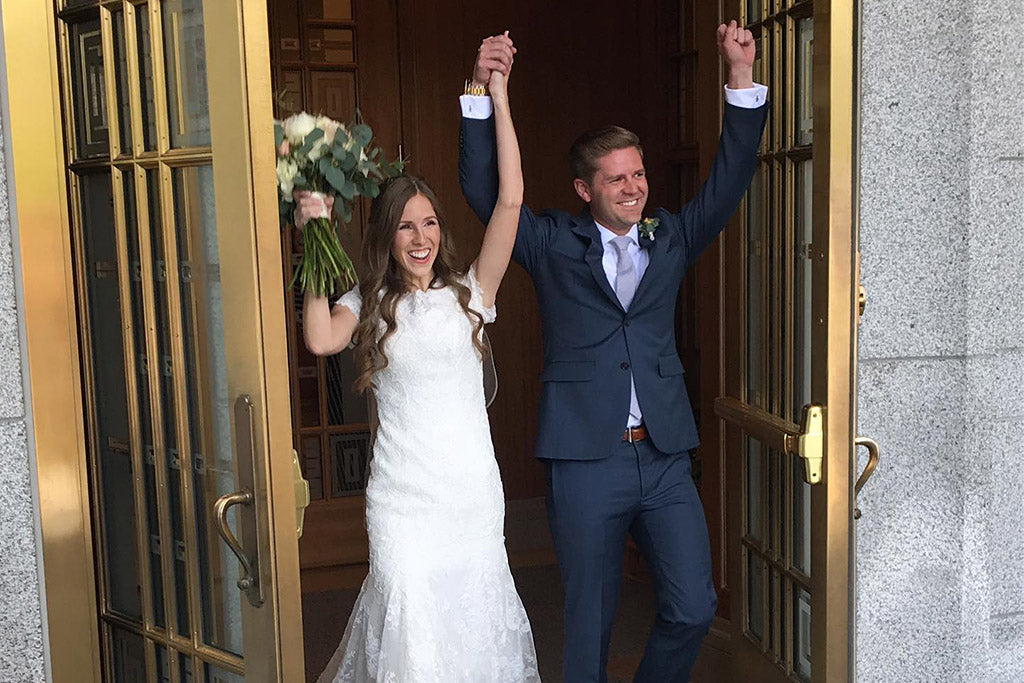Austin and Jill Patten celebrate after getting married.