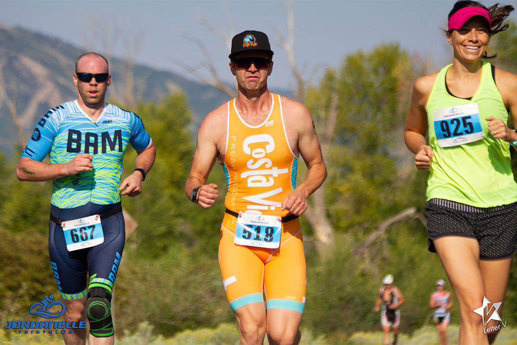 Austin Patten running in Jordanelle Triathelon with two other racrs.