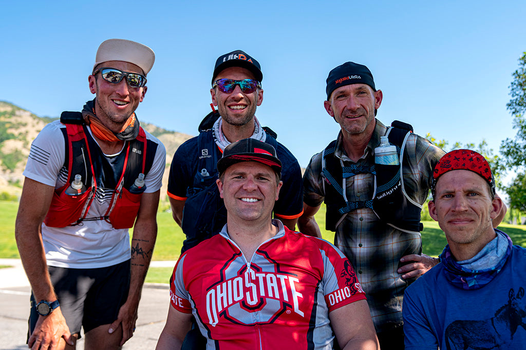 Five endurance athletes posing for picture at Gibbons Park, Logan, UT - the traditional starting point of the Bear 100 ultramarathon. Michael Mcknight, Dax Hock, Ben Light, Austin Patten, Josh Nuckles