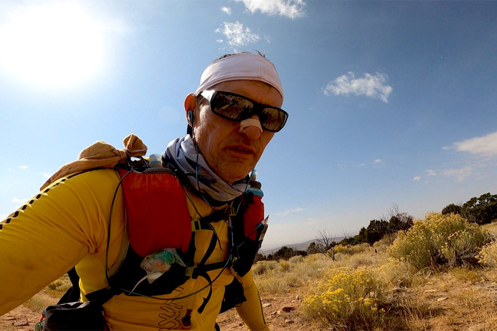 Phillip Lowry on the trail climbing to mile 187 at Moab 240