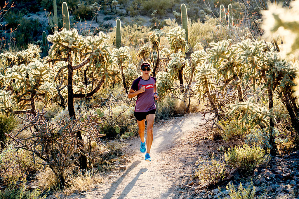 Lisa Roberts running through the Tuscon, Arizona dessert.