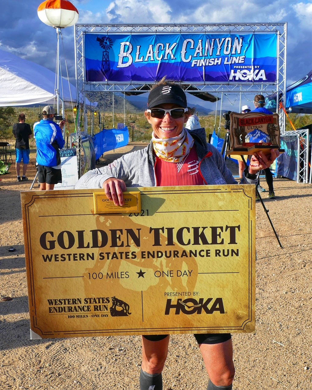 Lisa Roberts holding the Western States golden ticket after taking second at Aravaipa Running Black Canyon Ultras, Black Canyon, AZ
