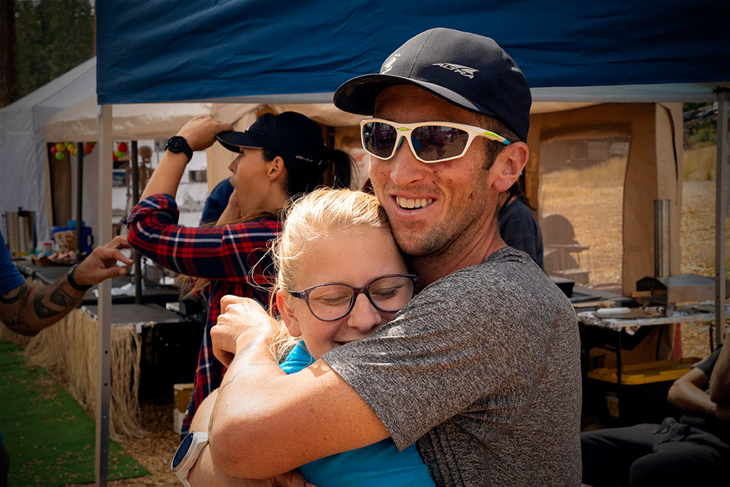 Michael McKnight hugging his crew (wife Sarah) after finishing the Tahoe 200 mile ultramarathon