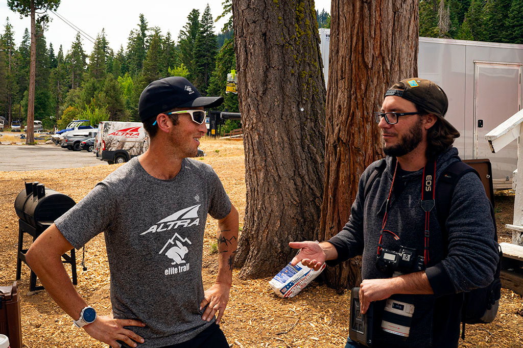 Michael McKnight being interviewed by reporter after finishing the Tahoe 200 mile ultramarathon