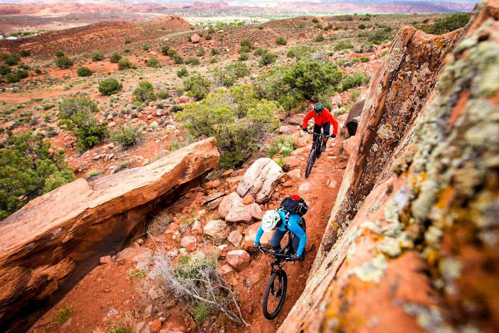 Two mountain bikers on Moab Brand Trails in Utah