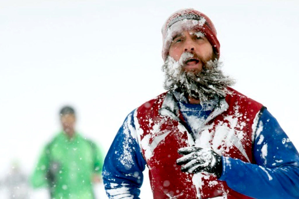 Runner in snowstorm with frozen beard
