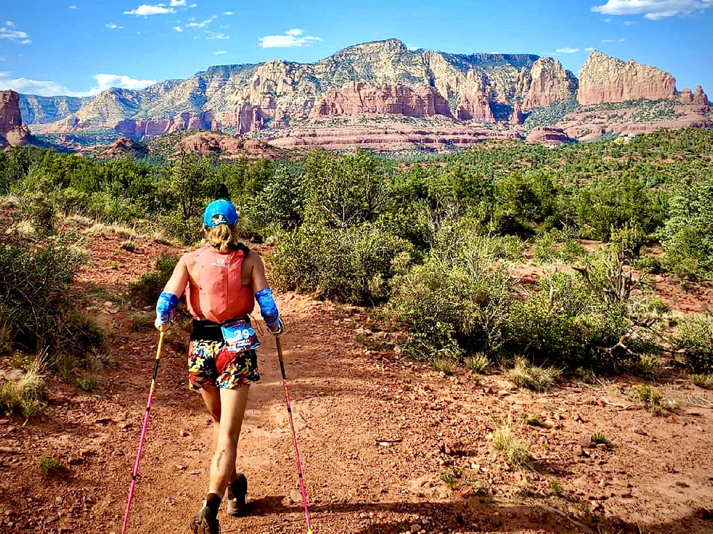 Trail runner Shelby Farrell running on trail into the Sedona valley.
