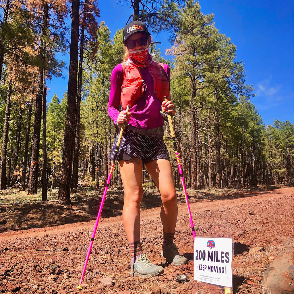 Trail runner Shelby Farrell at mile marker 250 on the Cocodona 250 trail.