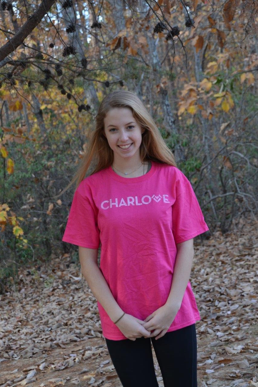 Wear this PInk Charlotte T-Shirt to show your love and pride for Charlotte while giving back to a child in need.