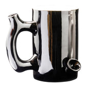 Black Ceramic mug that is also a pipe.  The mouth piece is on the handle and there is a bowl attached to the mug