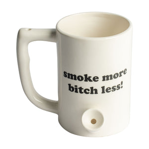 "White mug that is also a pipe. It has the phrase ""Smoke more bitch less"" written on the front"
