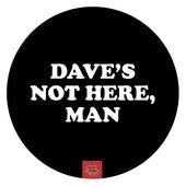 Black circular dab mat with white writing Daves not here, man.