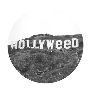 Dab Mat with the Hollywood sign, but it say holly-weed