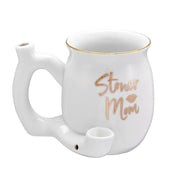 White coffee mug that is also a pipe.  It has gold writing on it that says stoner mom, and a lipstick mark.  Gold trim on the rim as well.