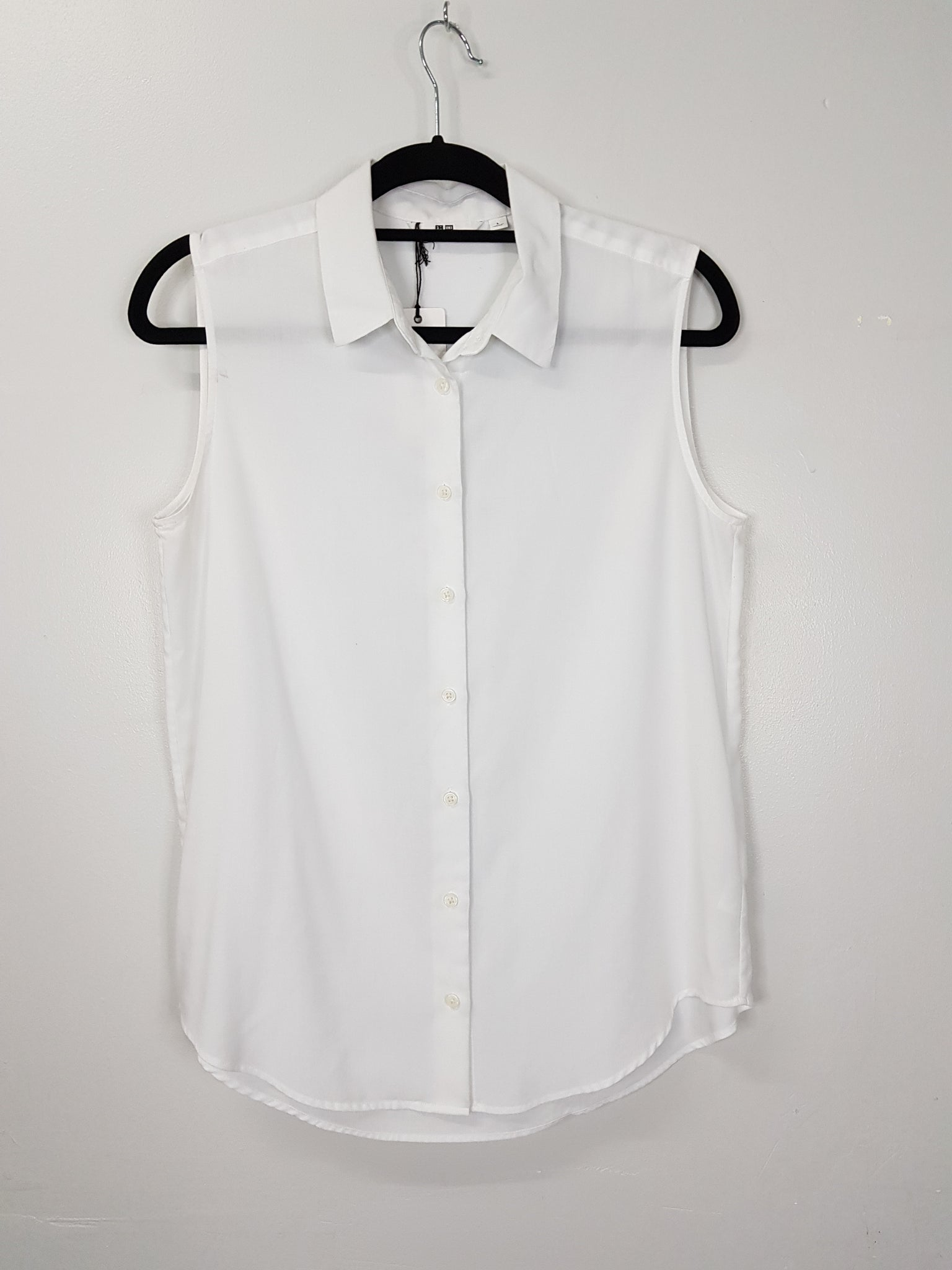 Uniqlo white sleeveless blouse