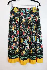 Front black floral design with pleets skirt