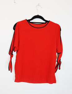 Threads red ribbon tie sleeve blouse with black pipe