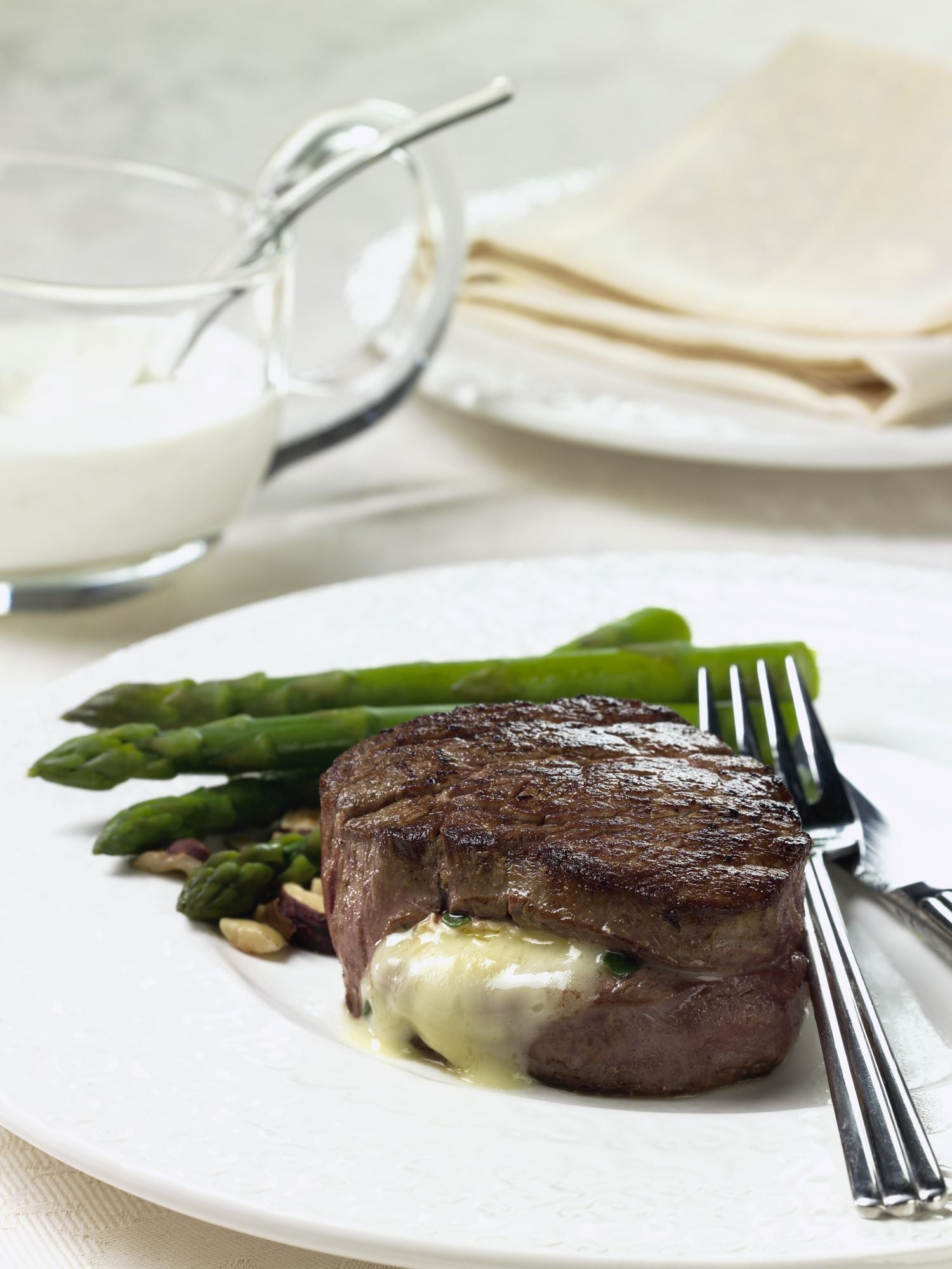 Brie-Filled Australian Beef Tenderloin with Horseradish Cream and Asparagus