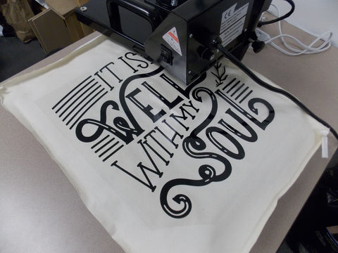 Heat press HTV on to the canvas.