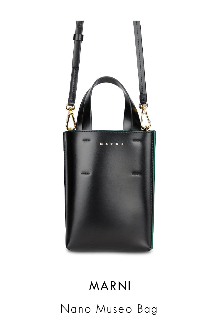 Marni black leather bag with a high shine finish and green piping on the edges