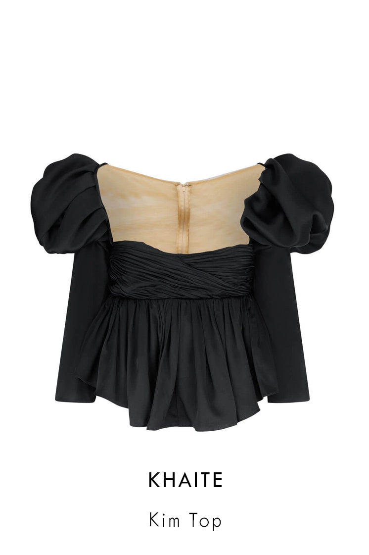Khaite black crepe back satin top with exaggerated puffed shoulders