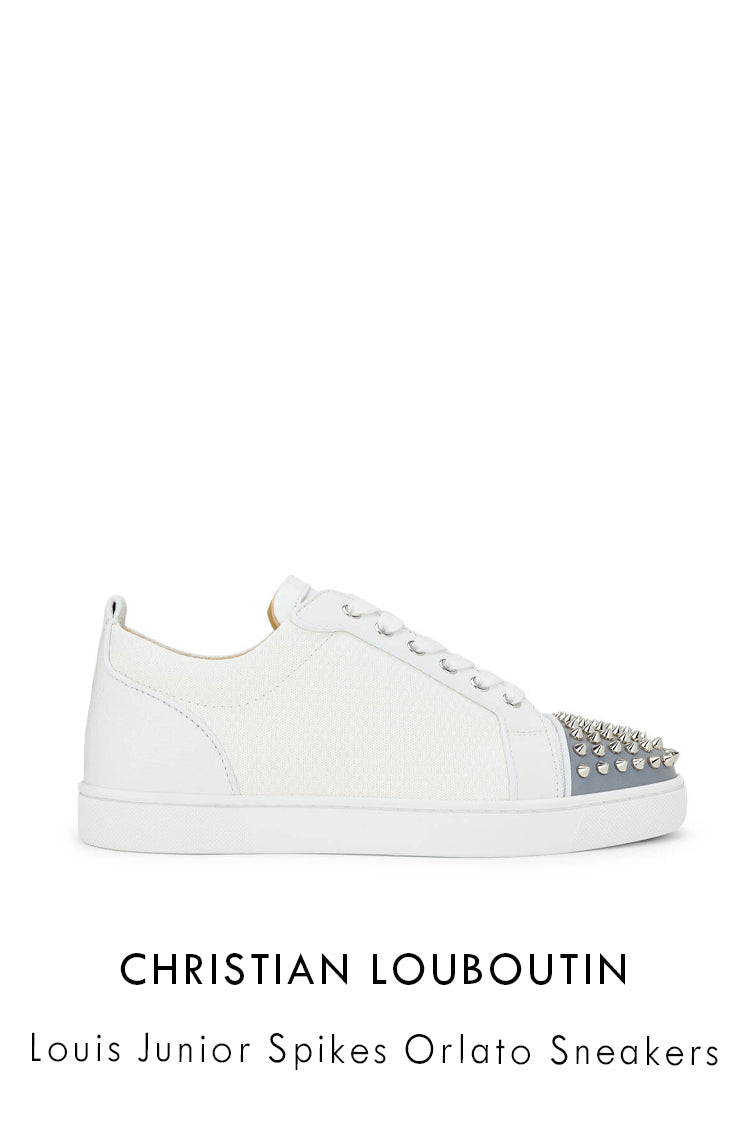 Christian Louboutin white low top sneakers in white with reflective material and spiked studs