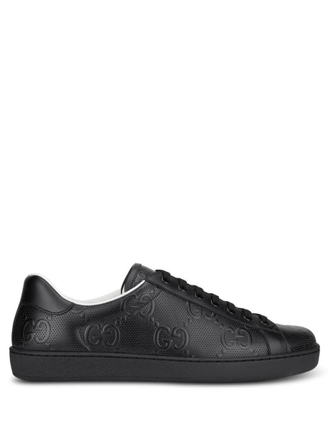 Men's Gucci Ace GG Embossed Leather Sneakers in Black. 6257871XK101000