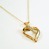 10 Karat Yellow Gold and Diamond Heart Pendant Necklace