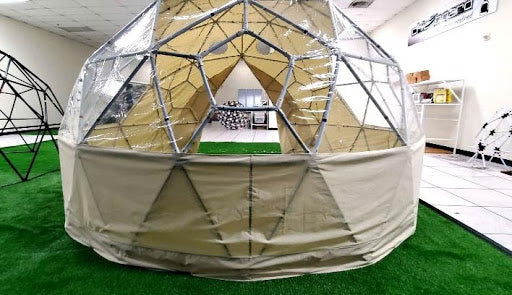 Testing the fit of a Sonstar mini glamping dome cover on a pentagonal window structure.