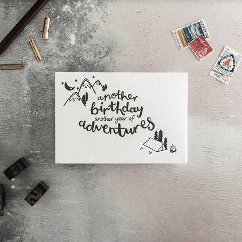 "Hunter Paper Co Another Birthday Another Year of Adventures Greeting Card This card has a beautiful illustration of a mountain and tent with the words ""Another birthday, another year of adventures"" is perfect for wishing a wonderful birthday. Printed on a letter press, Birthday Greeting card"