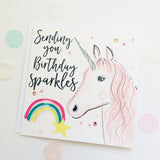 Beautifully designed Birthday card with the words sending you Birthday Sparkles with an illustration of a unicorn and rainbow. Perfect greeting card for little girls birthday.