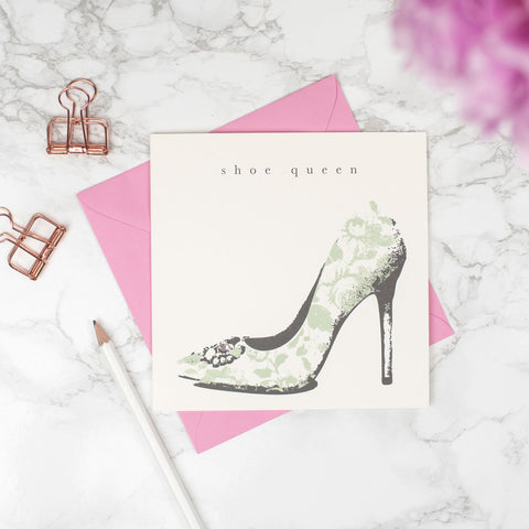 "Studio Seed Shoe Queen Greeting Card This beautiful stiletto shoe designed card , with the words ""shoe queen"", hand finished with a Swarovski crystal for a touch of lux is perfect for every shoe addict. This is not just a card but a keepsake your loved ones can treasure forever."