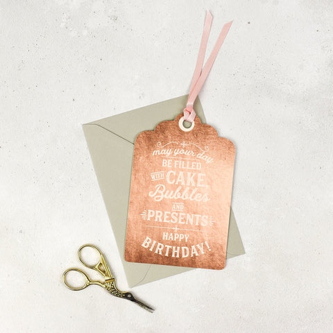 Studio Seed May Your Day Be Filled with Cake & Bubbles Birthday Card Send someone birthday wishes with this beautiful card. You can use it has a greeting card or a special gift tag, finished off with a lux pink ribbon.