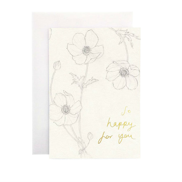Wanderlust Paper Co Anemone So Happy For You Greeting Card Beautiful hand drawn anemone floral design card with the words So Happy For You in gold foil lettering. All cards are accompanied by a unique translucent envelope to show the card design. Card is blank inside.