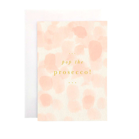 Wanderlust Paper Co Dusty Pink Pop The Prosecco Card Greeting Card Beautiful hand painted dusty pink design card with the words Pop the Prosecco in gold foil lettering. All cards are accompanied by a unique translucent envelope to show the card design. Card is blank inside.