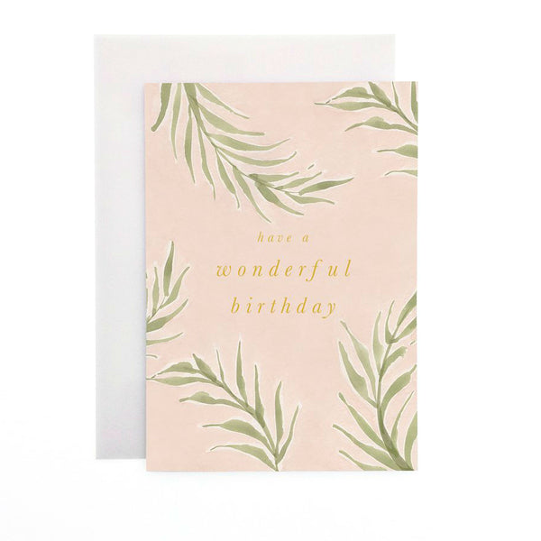 Wanderlust Paper Co Pink Palm Wonderful Birthday Greeting Card Beautiful hand painted pink palm leaf design card with the words have a Wonderful Birthday in gold foil lettering. All cards are accompanied by a unique translucent envelope to show the card design. Card is blank inside.