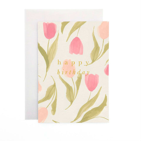 Wanderlust Paper Co Spring Tulips Happy Birthday Greeting Card Beautiful hand painted Spring Tulips flower design card with the words Happy Birthday in gold foil lettering. All cards are accompanied by a unique translucent envelope to show the card design. Card is blank inside.