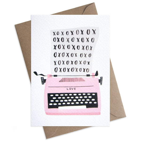 Paper Parade XOXO Typewriter Greeting Card This beautifully illustrated card is perfect for valentines day or just to let someone know how much you love them. Card is blank and is supplied with a brown envelope, pink typewriter, luxury greeting card