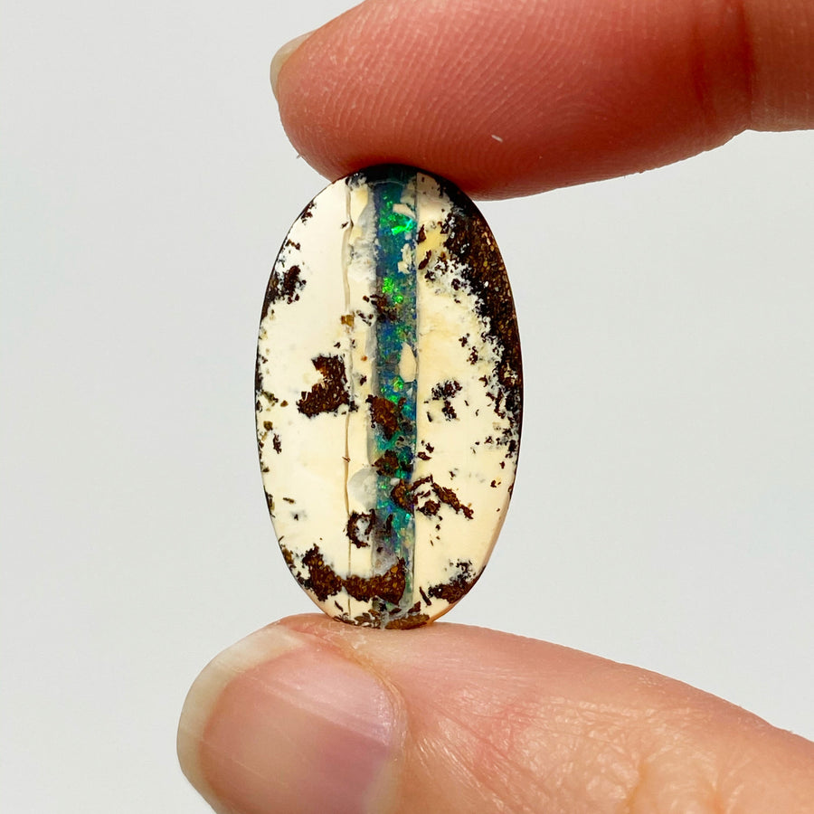 11.95 Ct green striped oval boulder opal