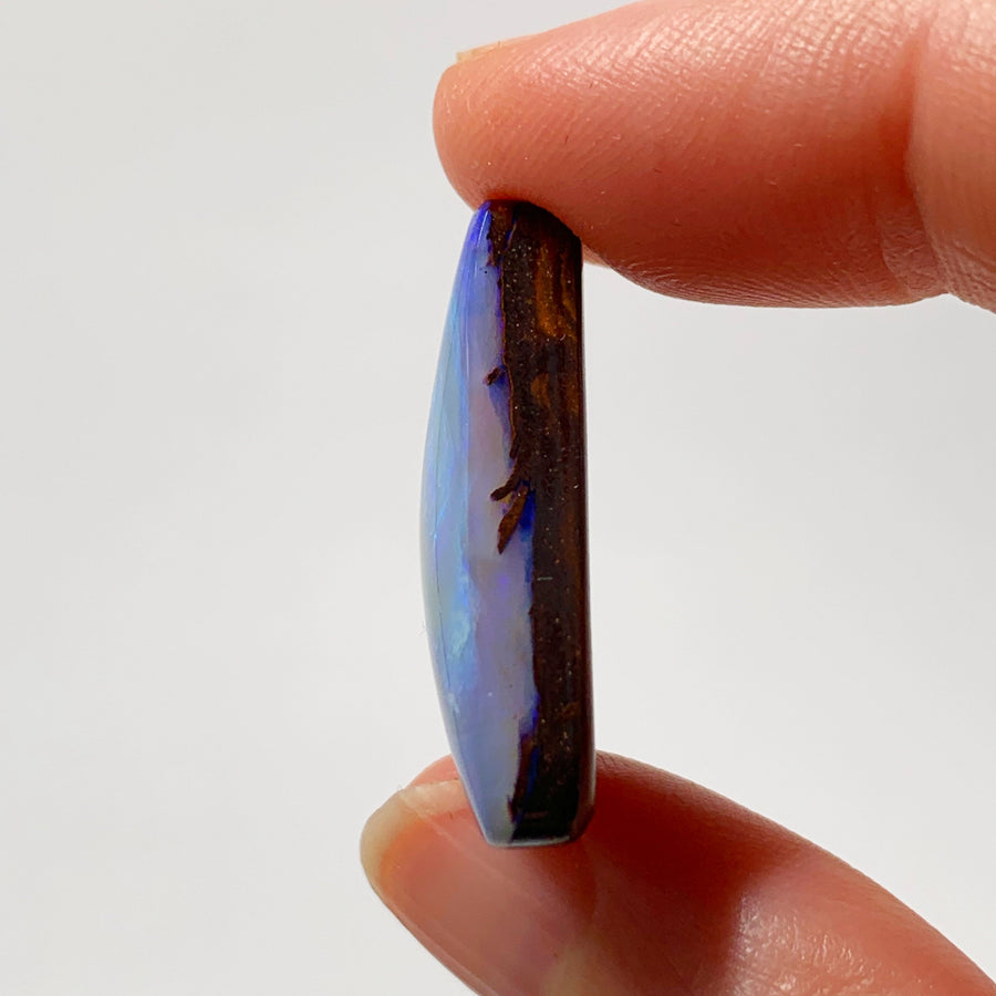 Australian Boulder Opal - 28.50 Ct Ct large purple and green triangle boulder opal - Broken River Mining