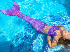 Mermaid costume in the pool