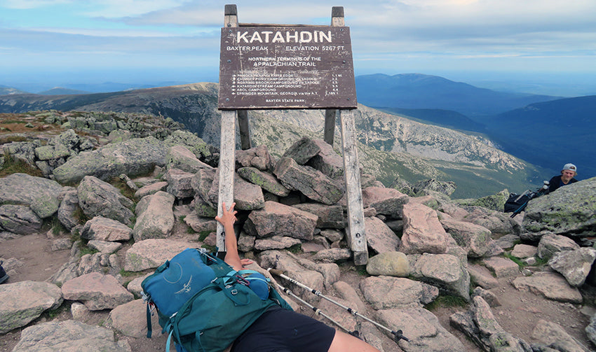 Michele collapsed at the foot of the Katahdin sign