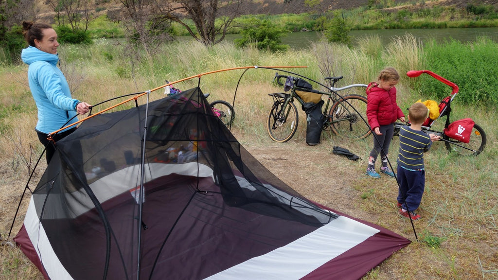 Packing away camp in the morning of a bikepacking trip