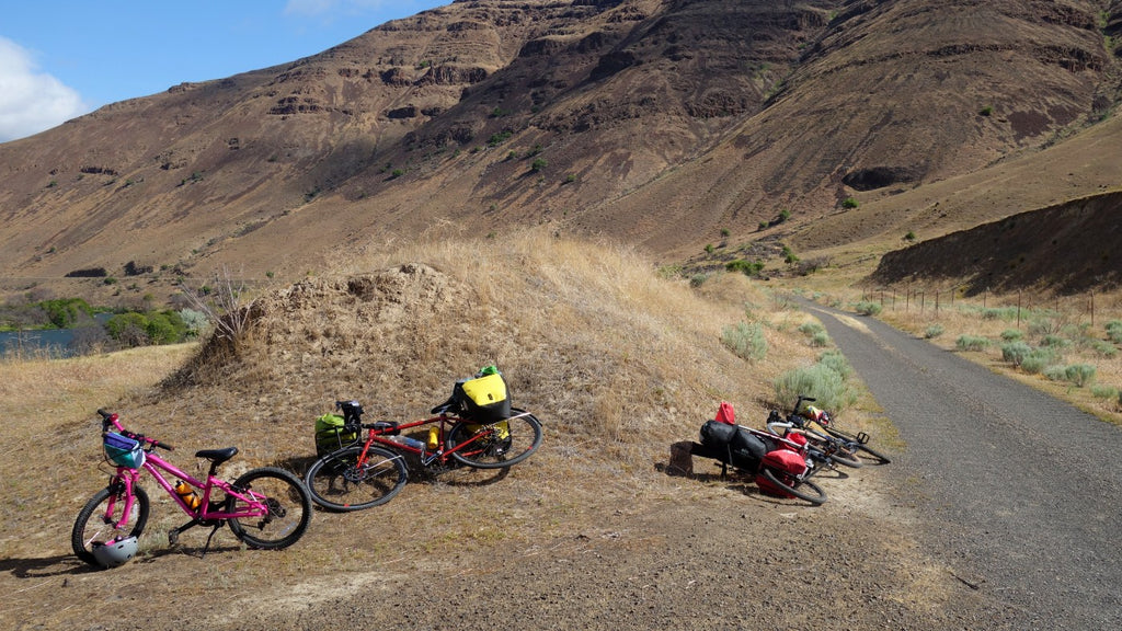 Bikes at the side of a gravel road